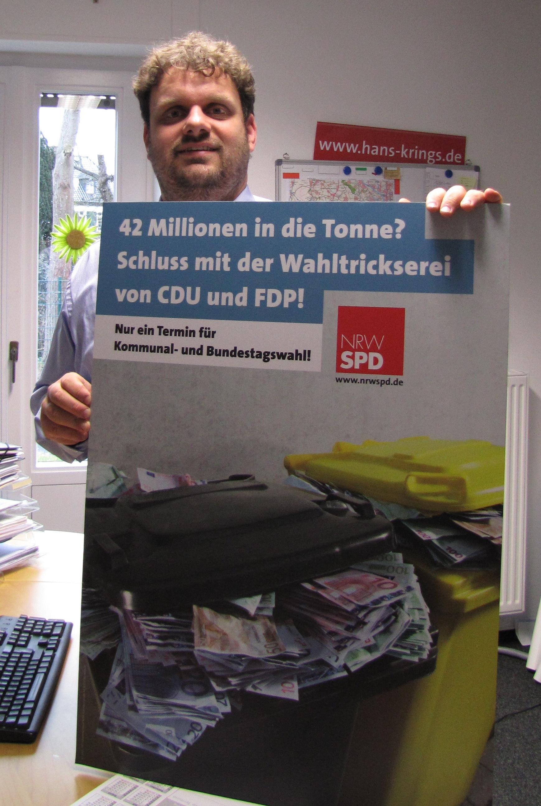 Guido van den Berg mit Plakat gegen Steuerverschwendung (2009)