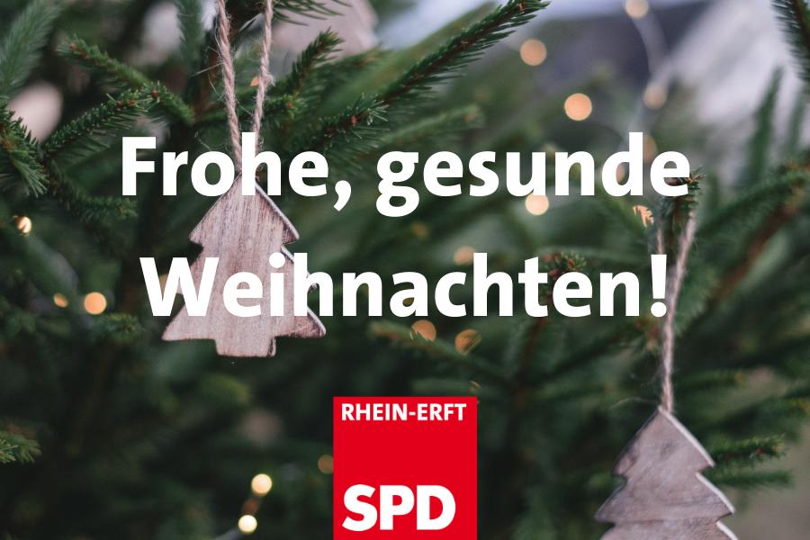 Frohe, gesunde Weihnachten (Text vor Weihnachtsbaumfoto)
